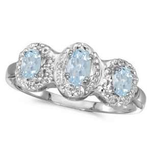 0.50tcw Oval Aquamarine and Diamond Three Stone Ring 14k