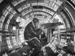 Crewman Poking His 50 Cal. Machine Gun Out of Side Window of B 17E