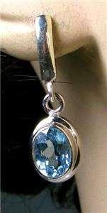 Sterling Silver 4.30ctw Oval Cut Blue Topaz Dangle Earrings 6g