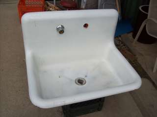 Antique Cast Iron Porcelain coated sink w/ back splash