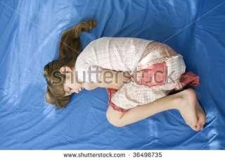 Little Sad Girl Lying On Bed. Stock Photo 36496735  Shutterstock